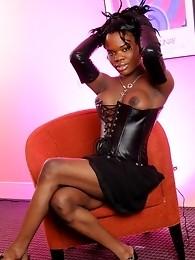 Ebony tgirl Elexa posing in hot leather corset