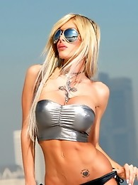 Irresistible Kimber James posing on the rooftop in LA