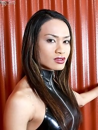 Notice Tranny Mistress Jules body language, she\'s ready for some action. She\'s poised and in control, looking powerful in her latex outfit