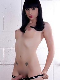 Busty brunette tgirl Bailey Jay posing her goodies