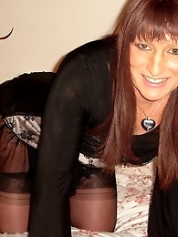 Long haired crossdresser with great smile posing